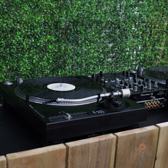 Turntable with our Rustic DJ Table and Flower Wall + Neon Sign