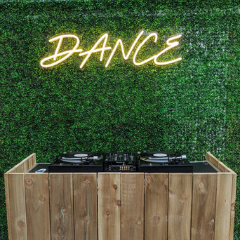 Rustic DJ Table and Flower Wall + Neon Sign