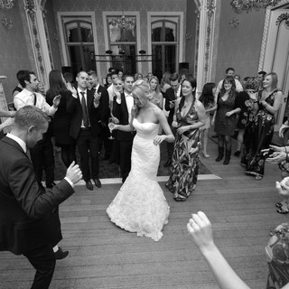 Claire and Chris enjoying the full dance floor. Another great example of our wedding disc jockey service.
