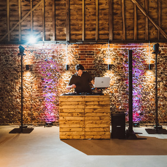 Rustic DJ Booth & Uplighting in the Wedding Barn at Old Hall
