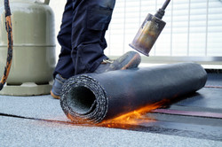 Flat roof installation with propane blow