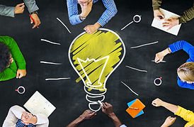 Group working together for light bulb inspiration