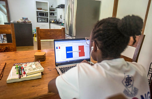 A young Trinidadian school pupil does her French lesson remotely online from Tobago