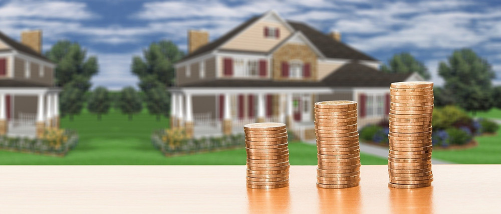 Stacks of coins in front of a house