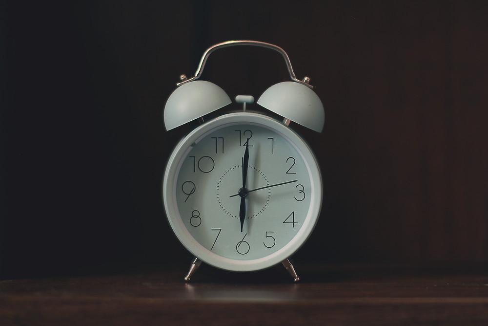 A white alarm clock