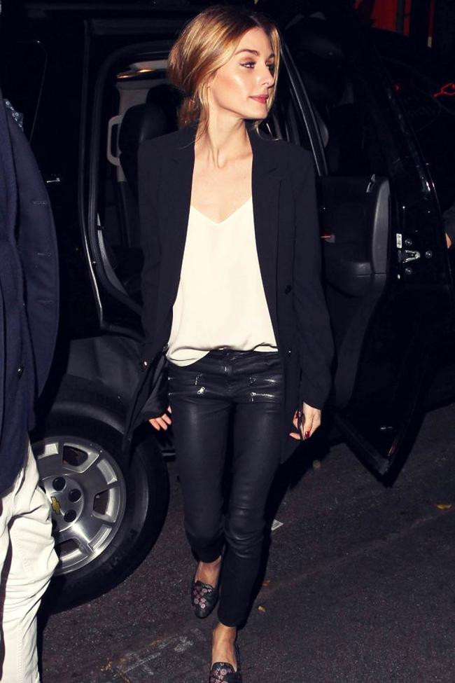 Olivia Palermo teams leather pants with a blouse and boyfriend blazer