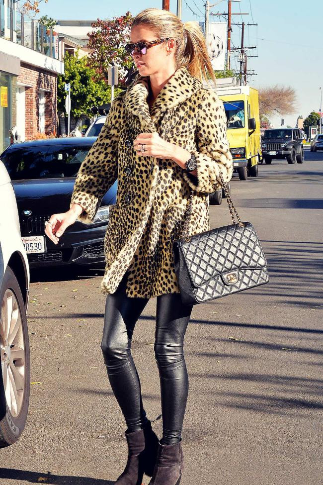 Nikki Hilton works her leather pants with leopard print and chanel