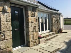 Main entrance and the sunny patio