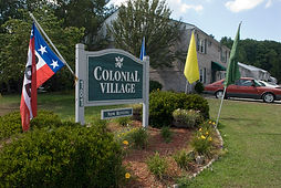 Colonial Village Apartments Front Sign - Click here to view Colonial's Homepage