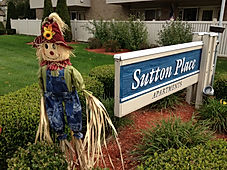 Sutton Place Apartments front sign in Autumn - Click to View Sutton's Home Page