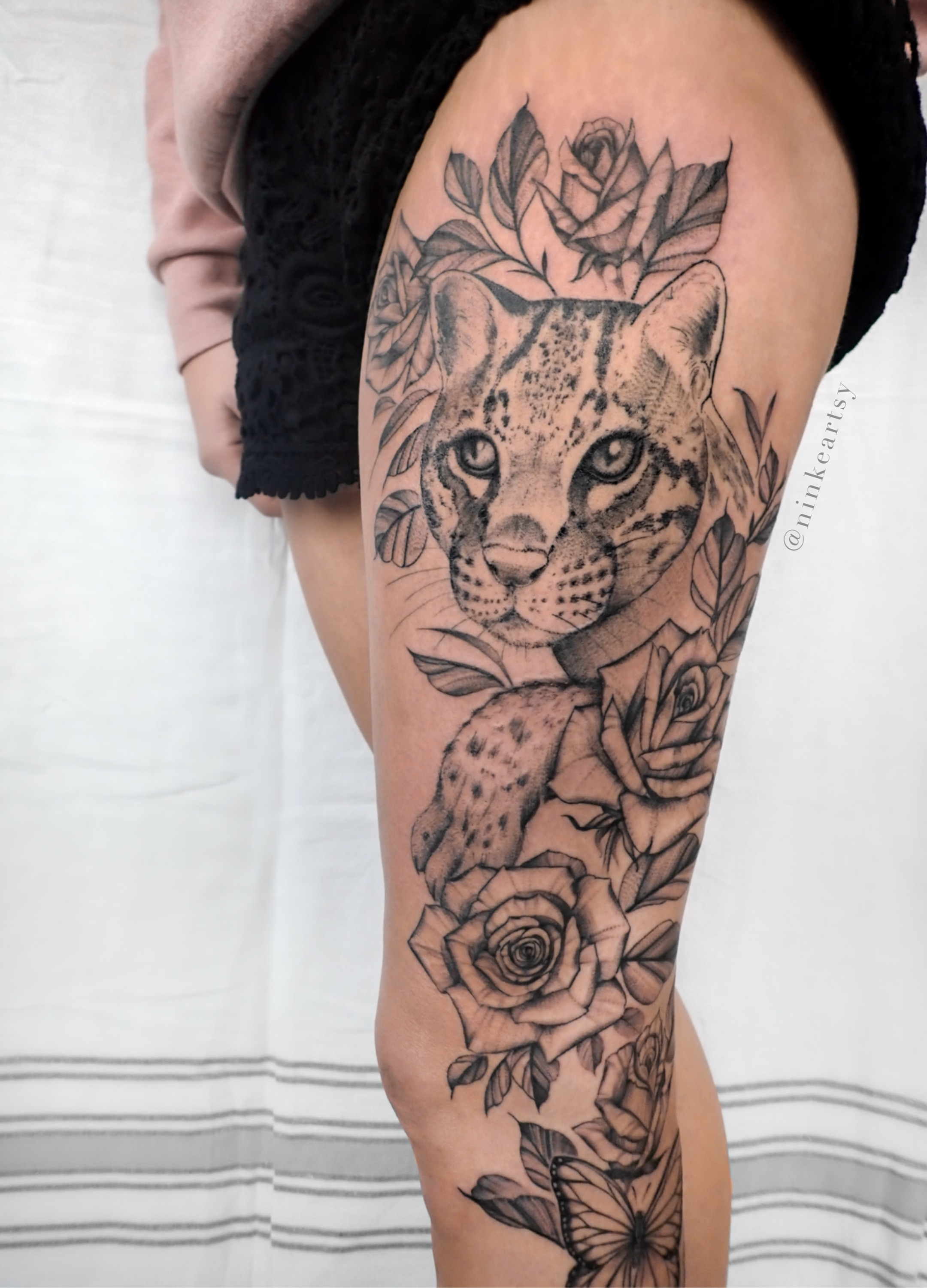 ocelot cat and roses
