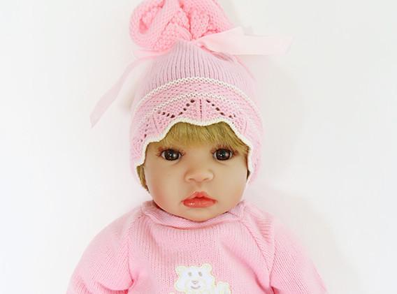 Courtney-brown-hair-brown-eye-pink-knit-
