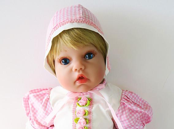 Mia-blonde-hair-blue-eyes-pink-gingham.j