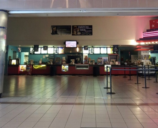 Cinema lobby, post Regal-rebranding, pre-renovation. The old arcade can be partially seen at right.