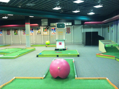 Indoor mini golf in the former Sam Goody store, 2013