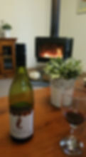 Enjoy a wine in front of the fireplace