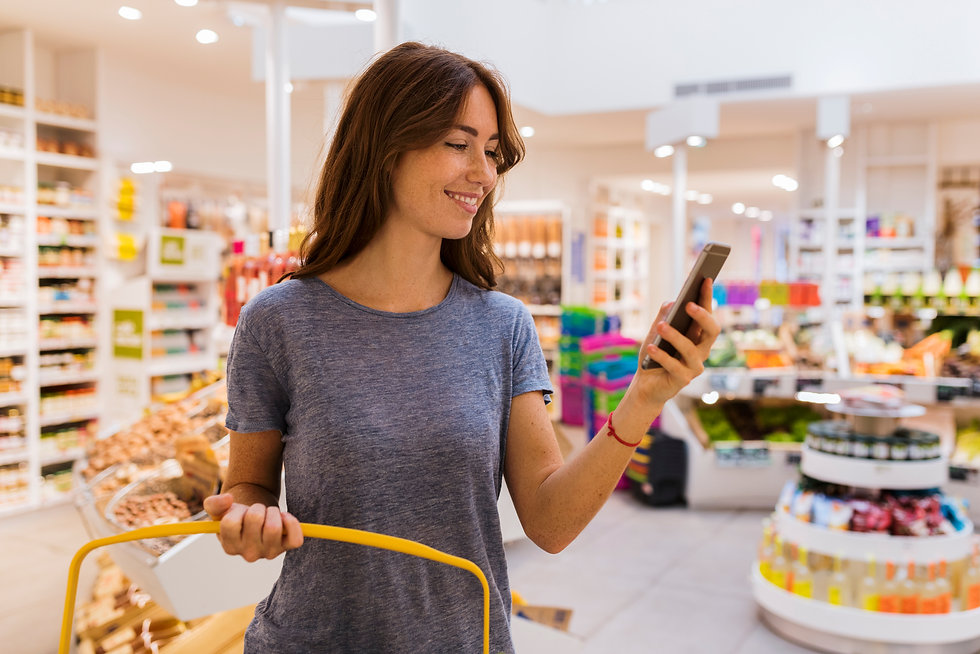 Woman Holding Phone While Shopping