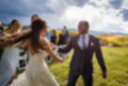 Couple dancing out of their Steamboat Springs, Colorado wedding