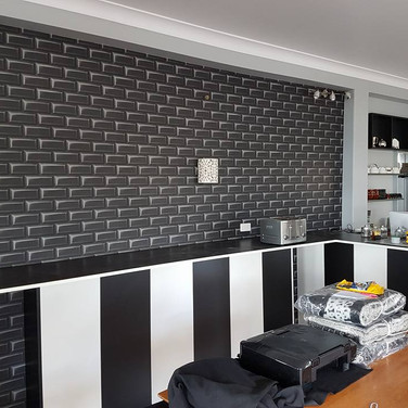 Kitchen Wallpapering by Andrew Gill.jpg