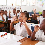 Kids showing hands during a lesson at an elementary school.jpg