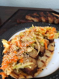 Open faced BBQ Tempeh Sandwich with Carrot Cayenne Coleslaw from Vegan Soul Kitchen prepared by Jackie