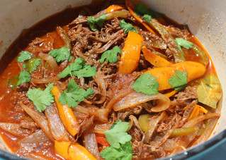 "Ropa Vieja (""Old Clothes"" Braised Beef with Peppers & Onions) from The Cuban Table prepared by Mary"