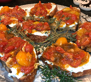 Cherry tomato crostini with homemade herbed goat cheese prepared by MaryLou