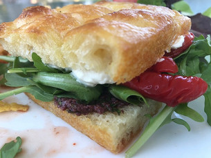 Slab Sandwich with Olive Tapenade Roasted Red Peppers and Whipped Honey Goat Cheese prepared by Jackie