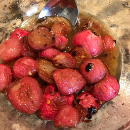 Roasted radishes, brown butter, chili and honey prepared by Christina