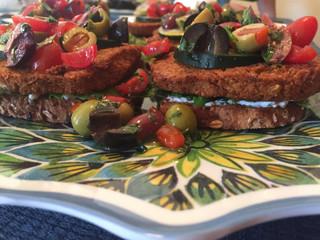 Greek Roasted Cauliflower Burgers with Pan-Fried Feta & Tomato-Olive Salsa  prepared by Shelley