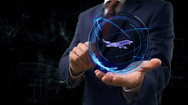 Businessman shows concept hologram 3d jet on his hand. Man in business suit with future te