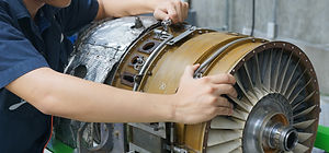Turbine is repaired by aircraft mechanic