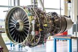Engine's maintenance in huge industrial hall.jpg