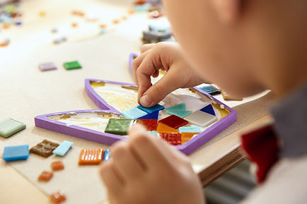 the-mosaic-puzzle-art-for-kids-children-s-creative-game-the-hands-are-playing-mosaic-at-ta