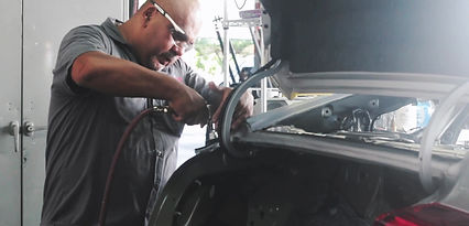 3 Stage auto collision repair center technicians fixing fenders, front and rear bumpers, car hoods.