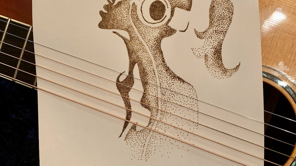 stippled image burned on thick art paper