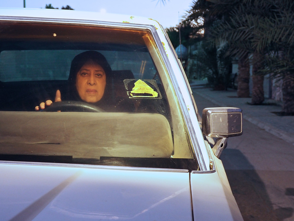 Dr Aisha Almana behind the wheel of the car she drove in 1990