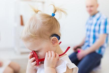 hearing-aid-in-baby-girl-39-s-ear-toddler-child-we-2G3HLAJ.jpg