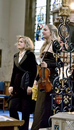 performing with violinist Litsa