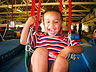 smiling-boy-in-swing.jpg