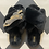 Thumbnail: Black Fluffy Slippers with Platinum Panther Brooch