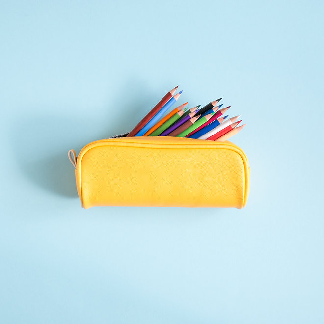Colored different school supplies on soft  blue paper background. Back to school backgroun