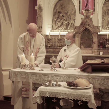 Mgr. Slattery Fr. Parker and fr. Philip renew their priestly commitment to serve their people.