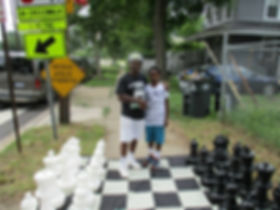 Eugene-Brown-with-Friend-Playing-Chess.j