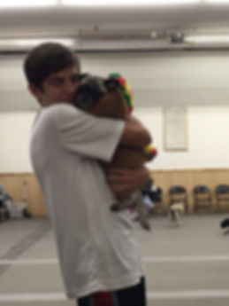 Kameron Richter hug a pug