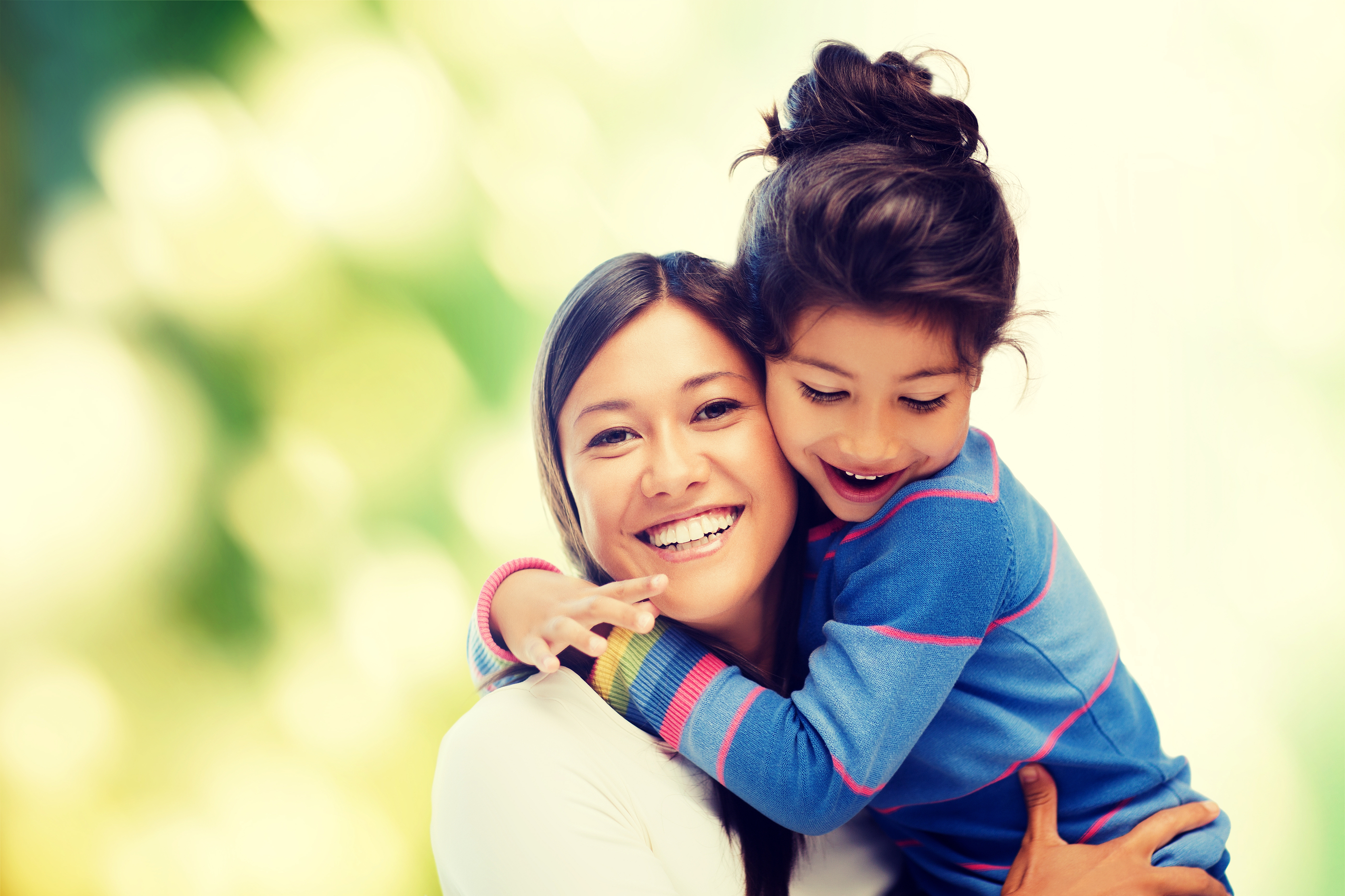 family, children and happy people concept - hugging mother and daughter