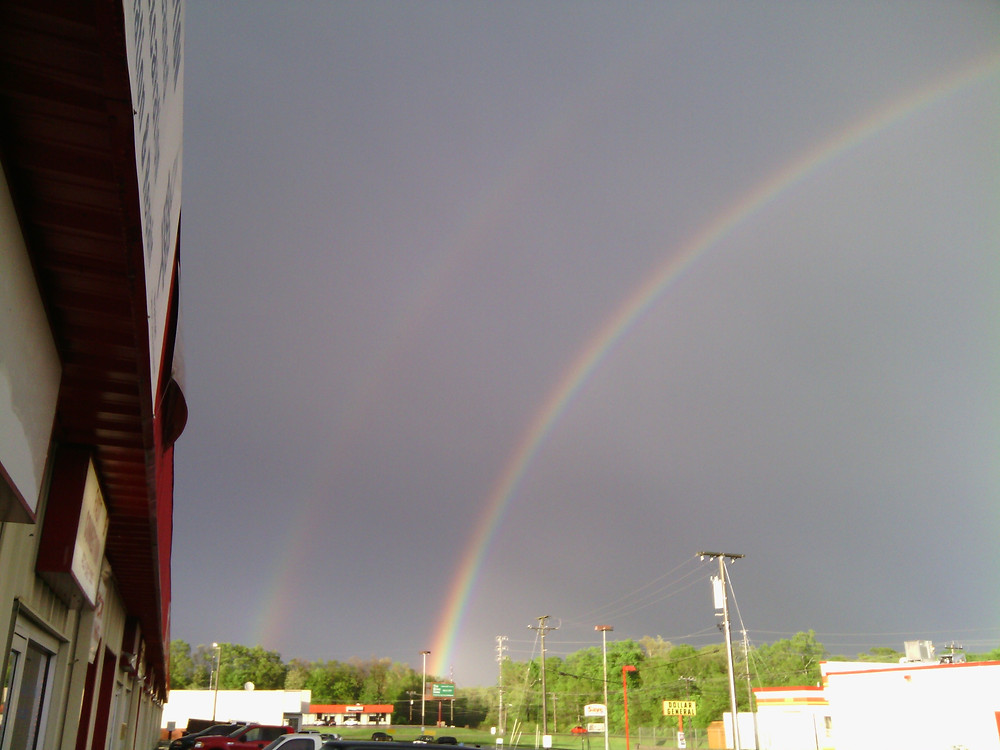 a double rainbow seen from my shops front door