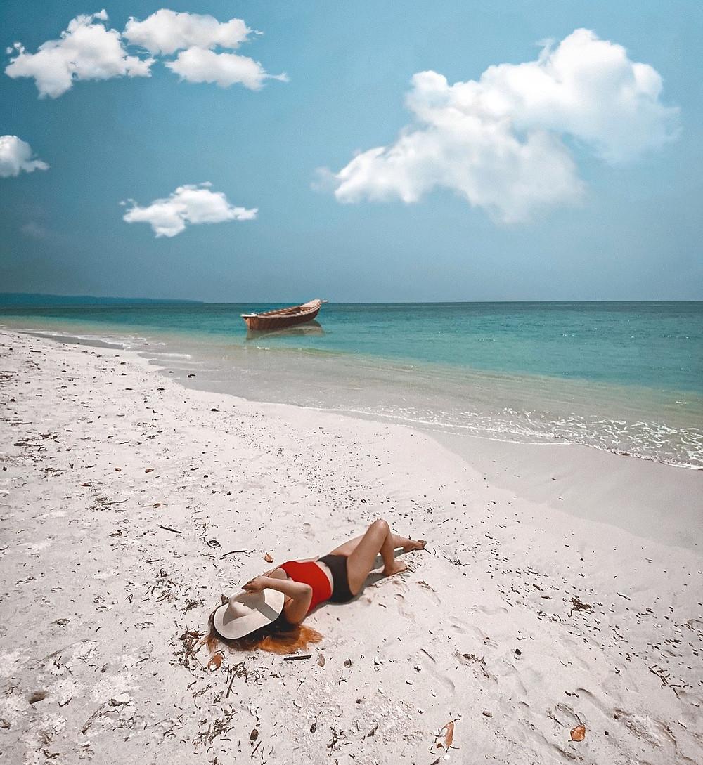 Sunbathing, Girl laying on the beach