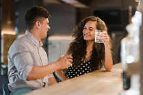 happy-couple-enjoying-drinks-bar_23-2147