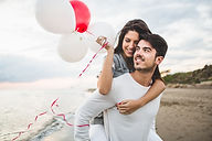 girl-smiling-with-balloons-while-her-boy